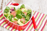 Salad. Spinach and quinoa salad with grapefruit and avocado