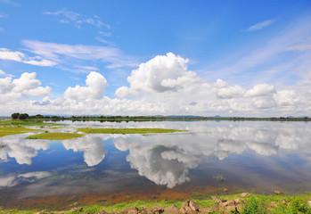 Cloud reflecting in serene lake
