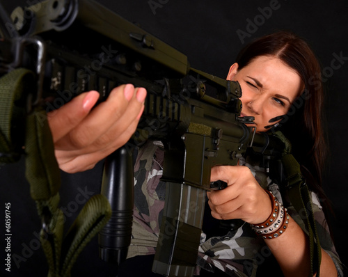 beautiful sexy girl holding rifle