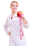Woman dietitian in lab coat recommending healthy food. Diet.