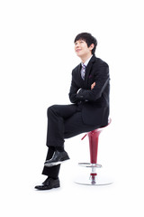 Young Asian business man sitting on the chair