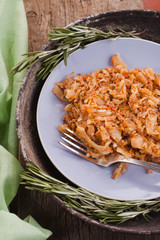 stewed cabbage on a plate with rosemary