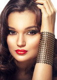 Closeup portrait of beautiful fashion woman with evening makeup