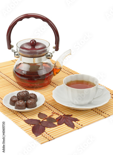 tea and tea utensils isolated on white background