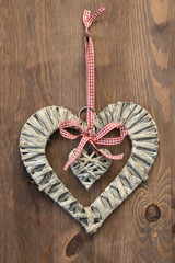 Heart and ribbon on wooden background