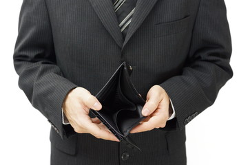 businessman shows empty wallet