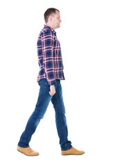 Back view of going  handsome man in checkered shirt.