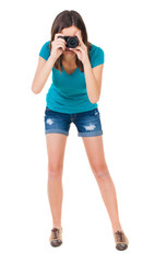 young woman in shorts photographed something compact camera.