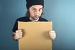 Man holding blank cardboard paper