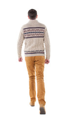 Back view of going  handsome man in a knitted sweater