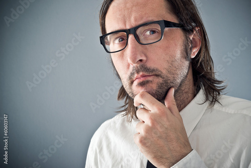 Businessman thinking, portrait with copy space
