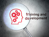 Education concept: Head With Gears and Training and Development