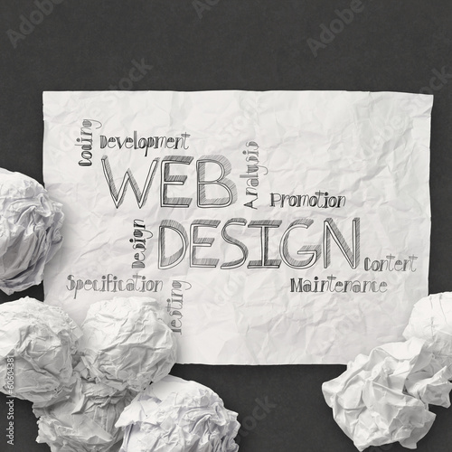 hand drawn web design diagram on crumpled paper background as c