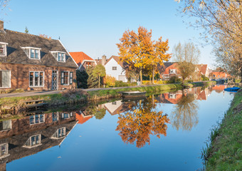 Reflected houses in a small Dutch village