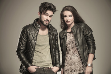 modern couple in leather clothes standing next to each