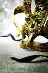 Vintage venetian carnival mask with glittering background