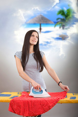 Woman ironing her clothes and dreaming of a vacation
