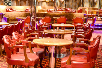 Bar scene with some red chairs and tables