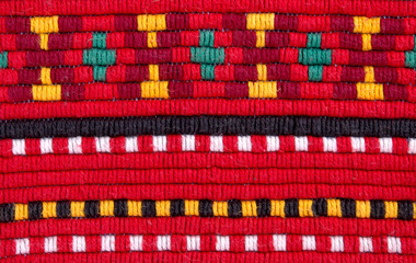 traditional materials and bulgarian embroidery red tint