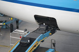 Conveyor plane with a suitcase