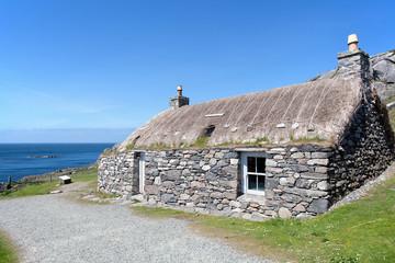 Traditional scottish black house on the edge of Atlantic Ocean