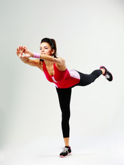 woman standing on one leg and exercising