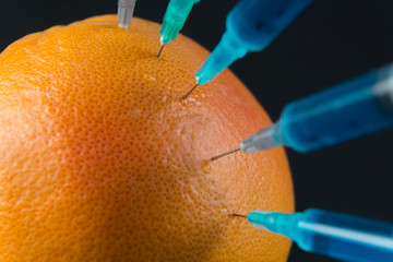 Grapefruit with syringes, close-up