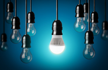 LED bulb and simple light bulbs.Blue background