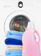 Towels with detergent and washing machine