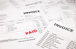 invoices and bills with paid stamp - 60613512