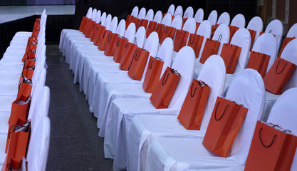 chairs in white covers in the hall for a fashion show