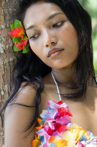 Girl rests on a tree
