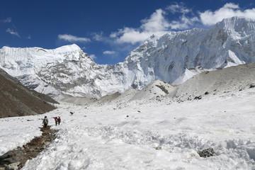 trekker  beside of everest basecamp from everest trek nepal