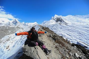 trekker on glacier beside of everest basecamp from everest trek