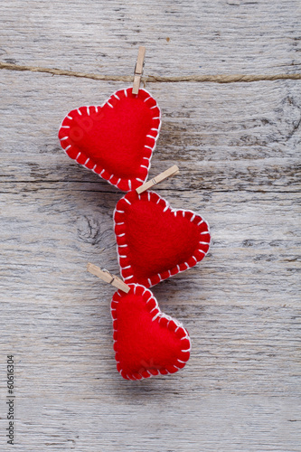 Red hearts hanging - 60616304