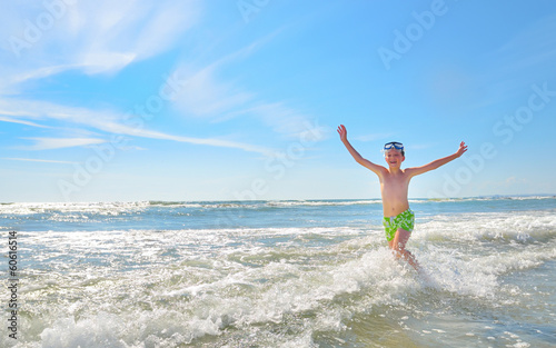 boy playing in waves