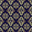 Luxury seamless ornamental Wallpaper: gold on dark blue.