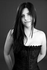 Gorgeous brunette posing in studio smiling