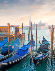 blue gondolas in Venice shore