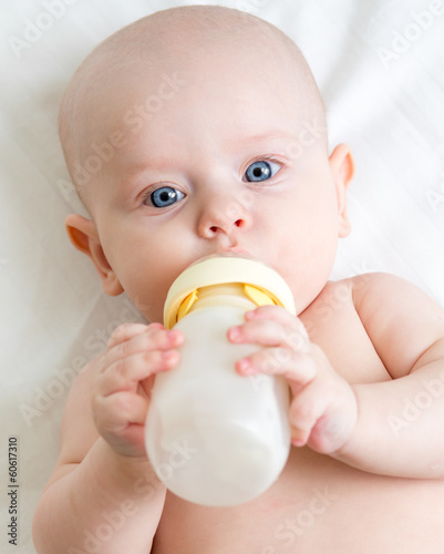 adorable child drinking from bottle