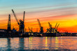 Port of Gdansk during the orange sunset.
