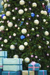 Happy new year tree with balls and blue gifts boxes