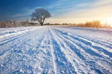 Winter road at sunrise