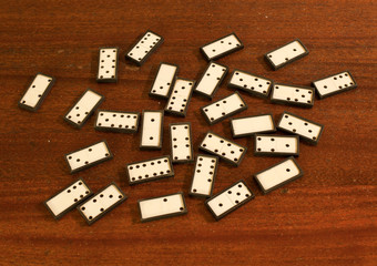 white dominoes scattered on the table.
