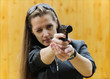 The young woman with a pistol