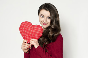 Beautiful brunette woman with red heart