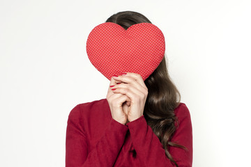 Young brunette woman with red heart