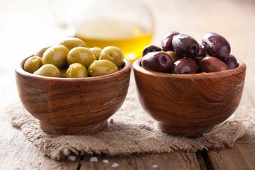 black and green marinated olives in bowl