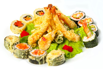 tiger prawns in tempura and hot rolls with lettuce leaves