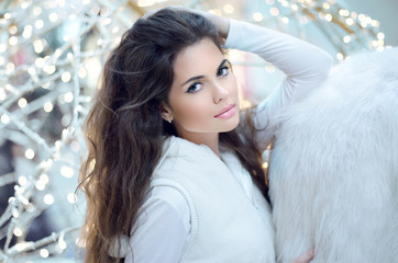 Winter Beauty Woman. Beautiful brunette girl with long hair posi